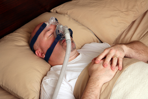 Older man doing his CPAP Therapy.