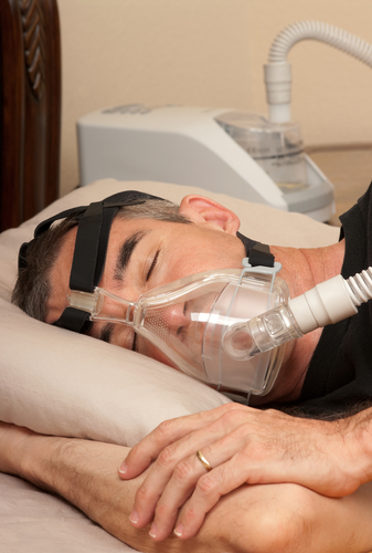 Man getting his CPAP titration study done.