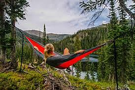 Woman enjoying camping outdoors.