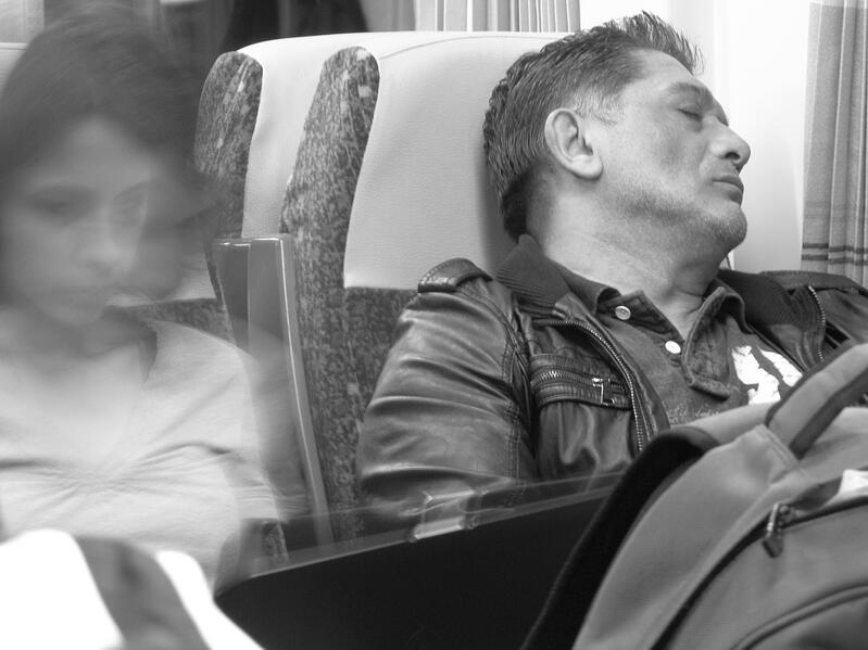 Man sleeping while commuting.