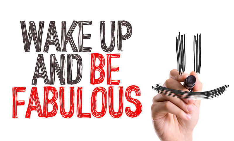 Hand with marker writing Wake Up and Be Fabulous