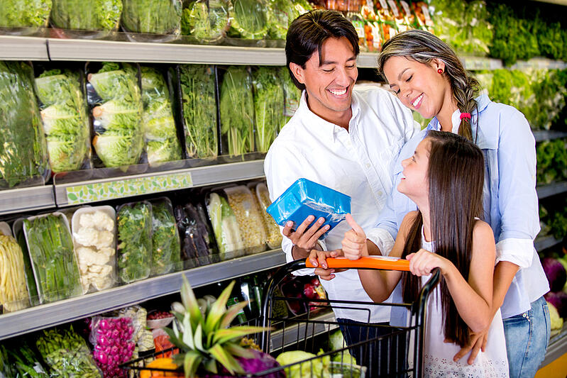 Happy family buying healthy food at the supermarket