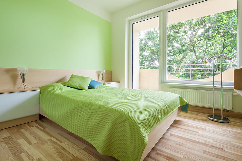 Horizontal interior of bedroom with green elements