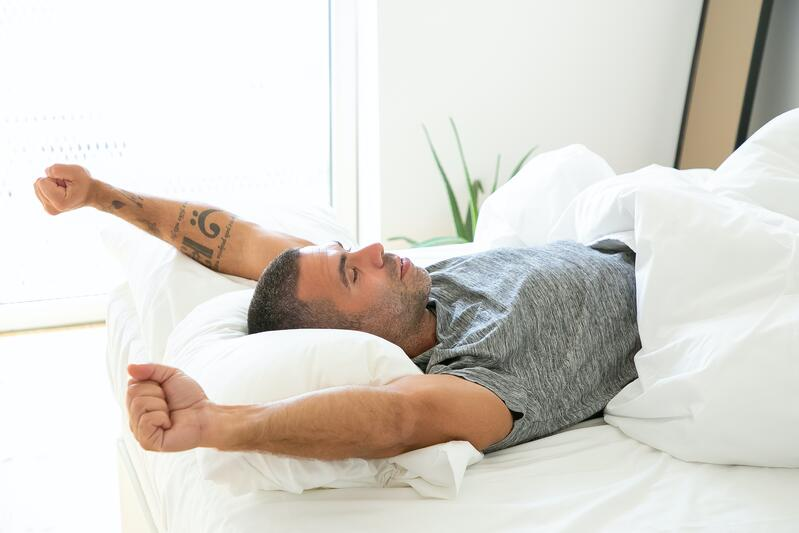 Man waking up refreshed for the day.