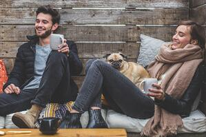 People relaxing with a cup of coffee.