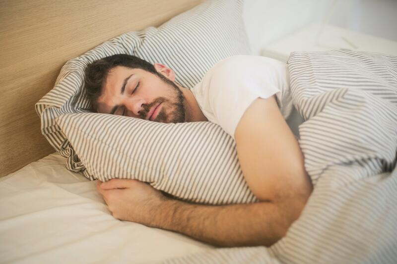 Middle-aged man getting quality sleep.