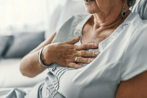 Older lady suffering from heartburn.