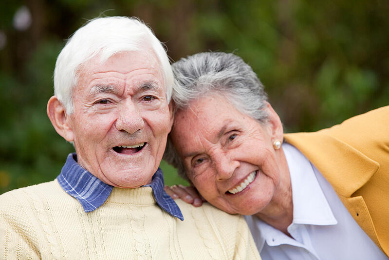 Portrait of a couple of elders smiling outdoors