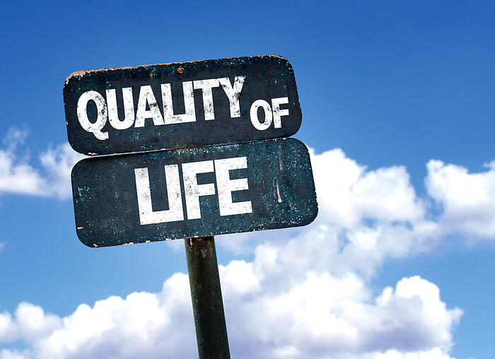 Quality of Life sign with sky background