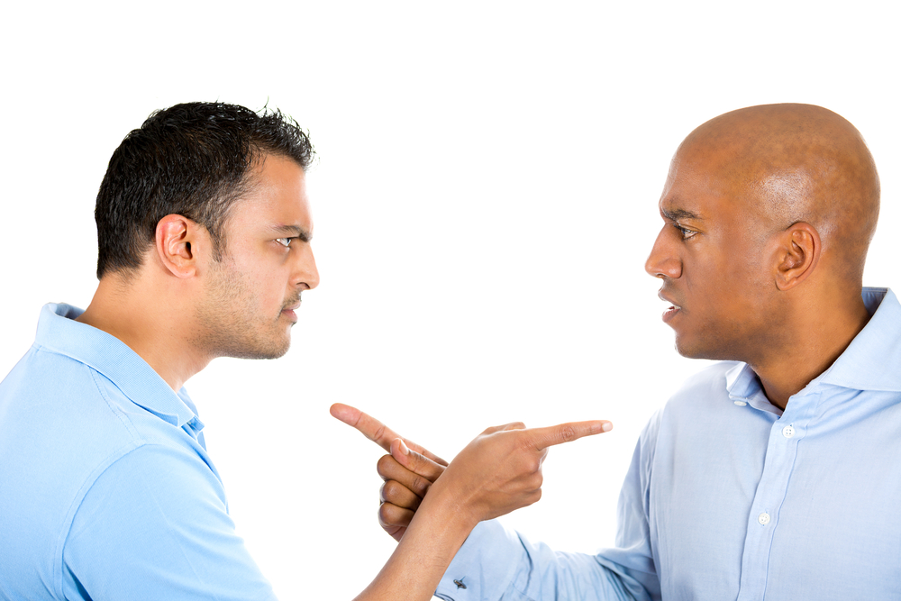 Closeup portrait of two angry guys pointing fingers at each other and blaming for problems.