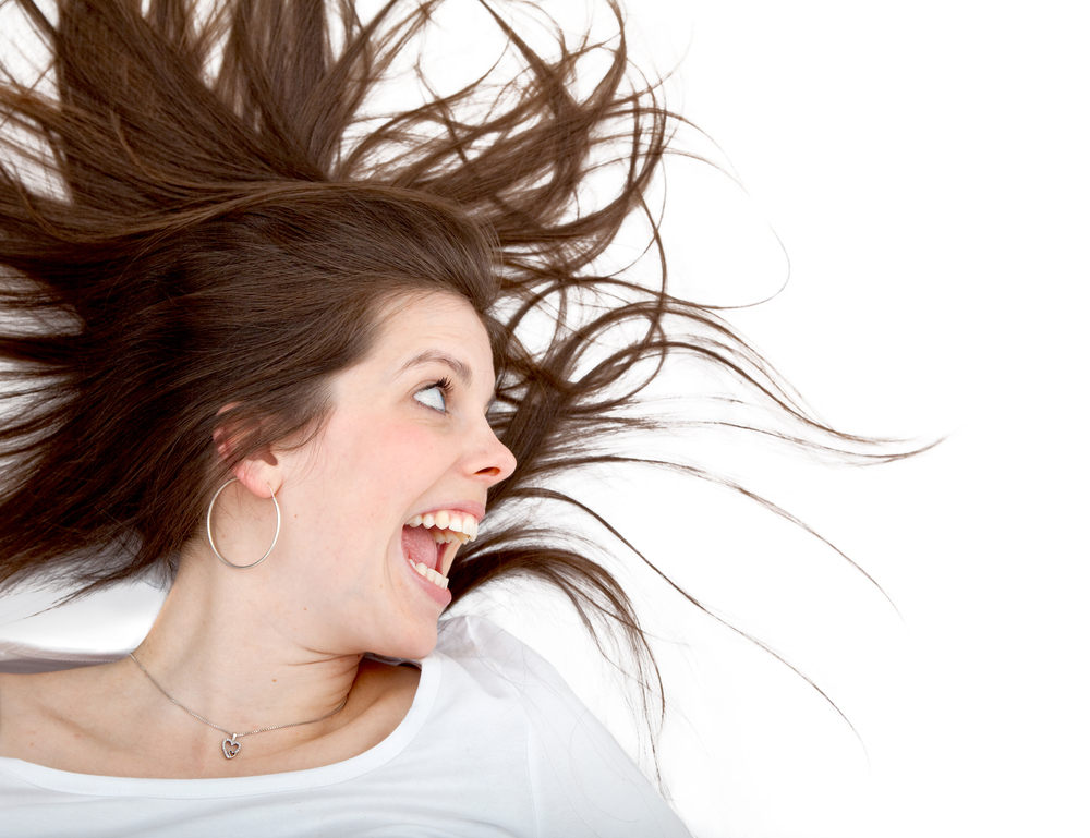 Crazy woman screaming isolated over a white background