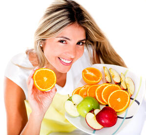 Healthy eating woman holding a tray of fruits - isolated over white