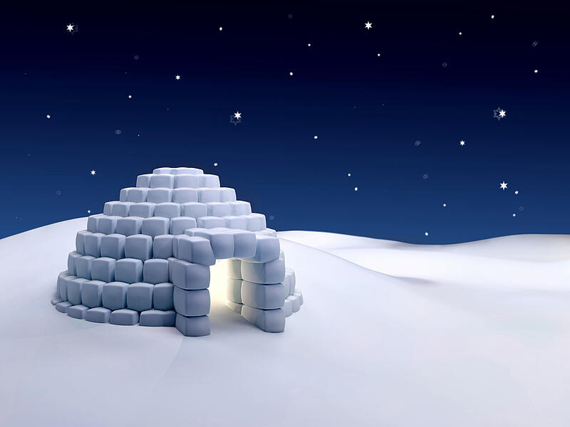 Igloo made with snow cubes at night