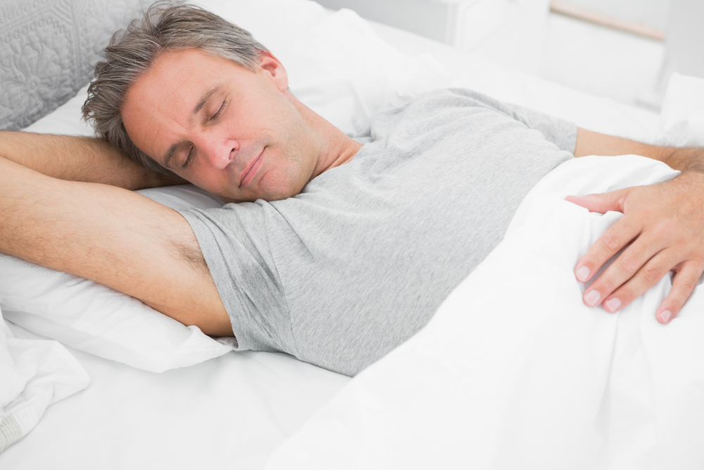 Man sleeping peacefully at home in his bed-1