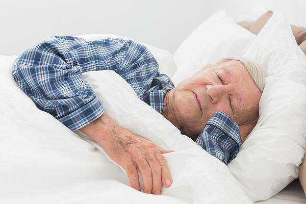 Old man sleeping on the bed-1