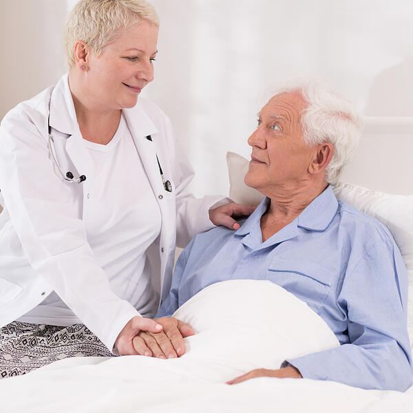 Photo of elderly patient having professional care at hospital
