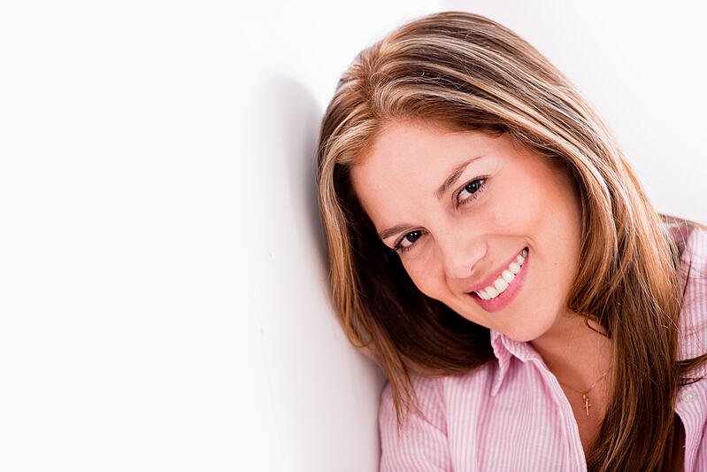 Portrait of a beautiful woman smiling and looking very happy