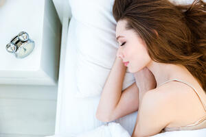 Portrait of a young woman sleeping on the bed at home-1