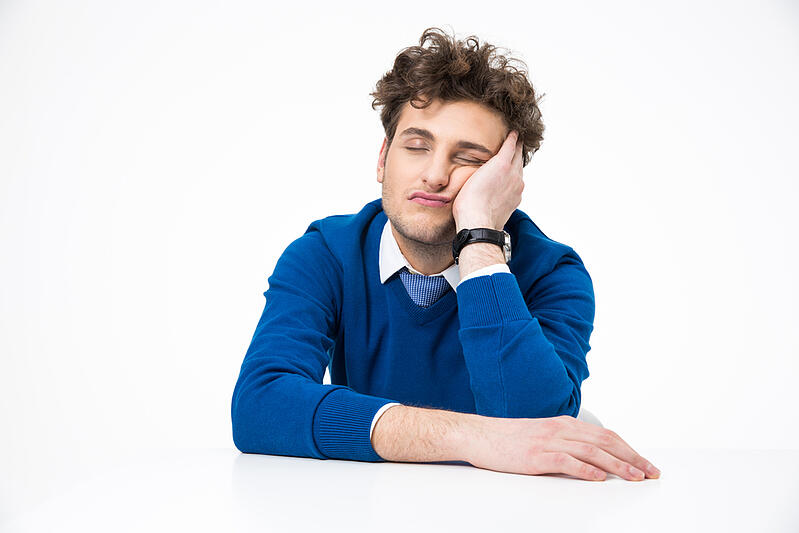 Tired businessman sleeping at the table over white background-1