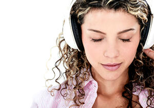 Woman with headphones listening to music - isolated over a white background-1