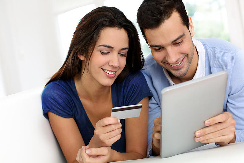 Young couple shopping online from home