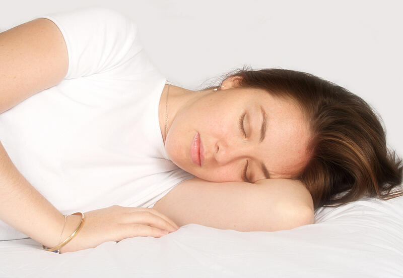 girl sleeping on a white bed - soft focus