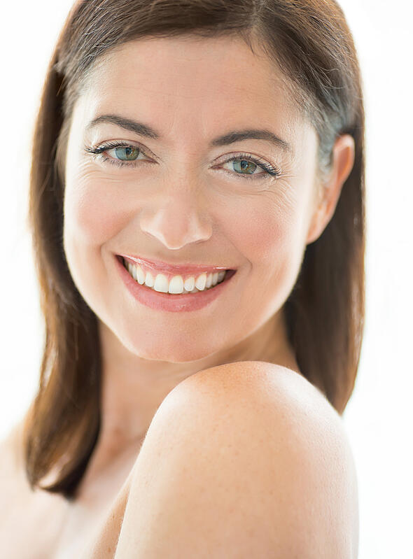 portrait of a beautiful mature lady looking at the camera with a confident smile