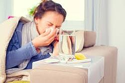 Woman sick and sneezing.